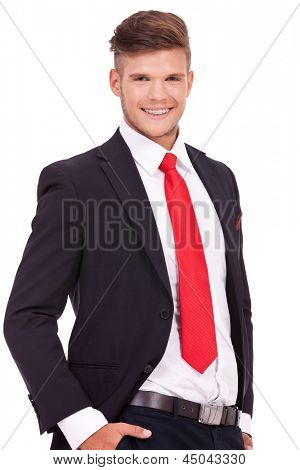 cutout picture of a young business man standing with his hands in his pockets and smiling to the camera. isolated on white background