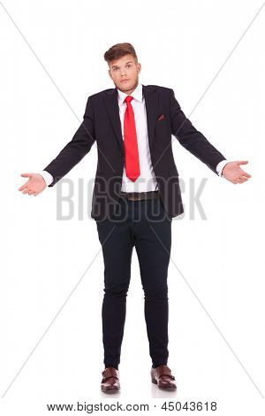 young business man raising his shoulders, not knowing what to say with an expressive figure. isolated on white background