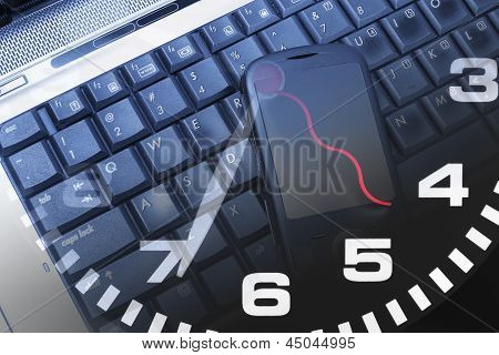 Laptop And Clock with Mobile Phone