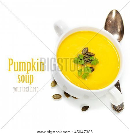 Traditional Pumpkin soup in white bowl  with ingredients (with easy removable sample text)