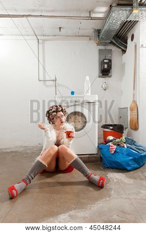 young woman in laundry, she drink