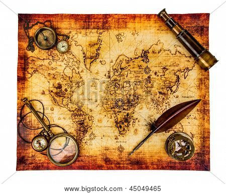 Vintage magnifying glass, compass, goose quill pen, spyglass and a pocket watch lying on an old map isolated on white.