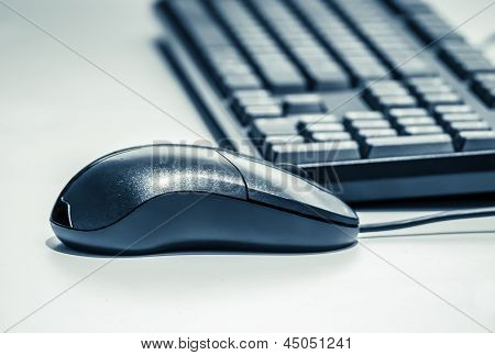 Computer Keyboard And Mouse Processed As Duotone