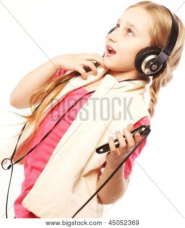 dancing little blond girl headphones music singing on white background
