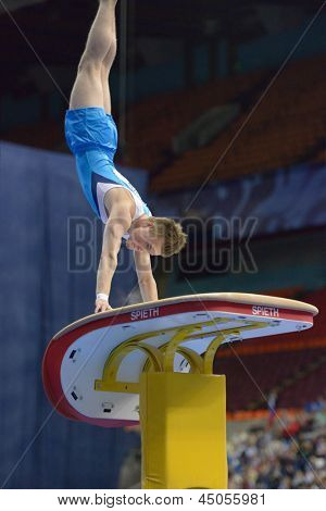 MOSCOW, RUSSIA - APRIL 21: Petrus Laulumaa, Finland performs vault in final of 5th European Championships in Artistic Gymnastics in Moscow, Russia on April 21, 2013
