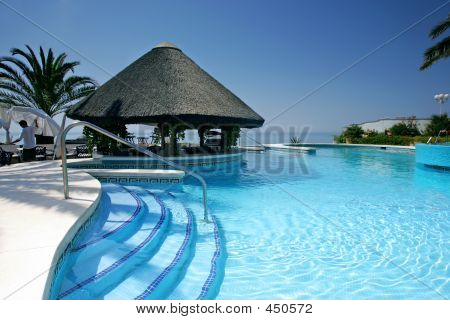 Tiki Hut And Bar By Swimming Pool Of Luxury Hotel