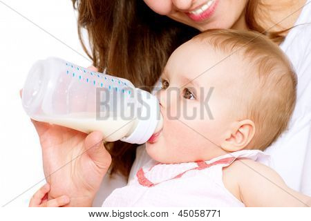 Feeding Baby. Baby eating milk from the bottle. Mother Feeds Her Newborn Baby