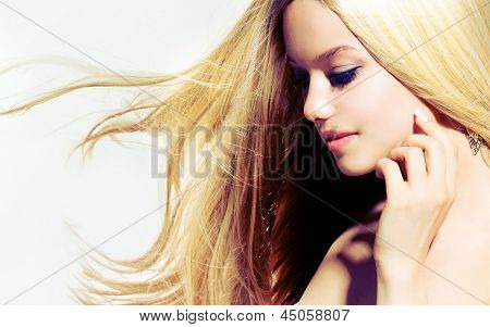 Beauty Blond Girl With Long Healthy Blowing Hair. Hair Extensions