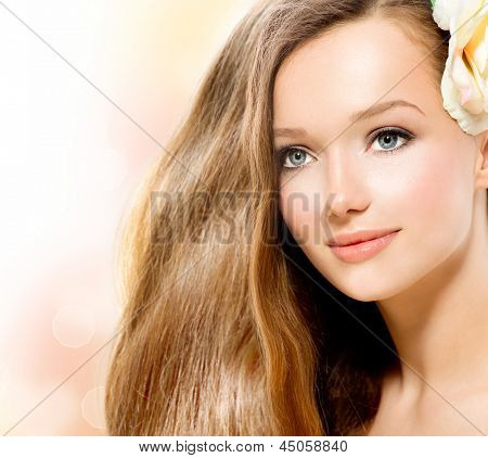 Beauty Girl. Beautiful Model Face. Healthy Long Hair and Perfect Clear Skin. Youth. Isolated on White Background. Skincare concept