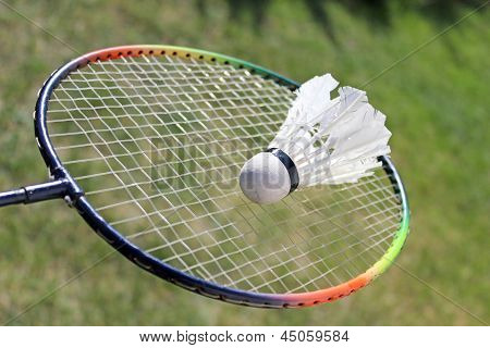 Badminton shuttlecocks on racket