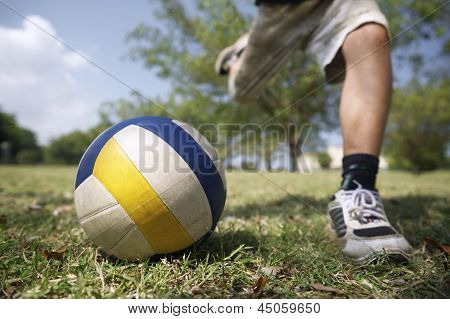 Kids Playing Soccer Game, Young Boy Hitting Ball In Park