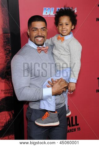 LOS ANGELES - MAR 05:  David Otunga & David JR arrives to the
