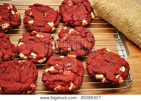 Cooling Red Velvet Cookies on a Wood Background