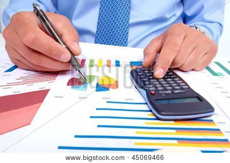 Hand with calculator. Businessman working in the office.
