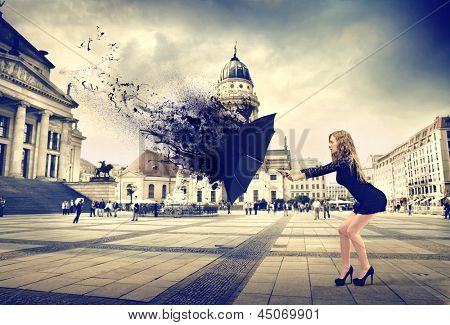 beautiful girl protects herself with umbrella