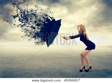 blonde girl protects herself with umbrella