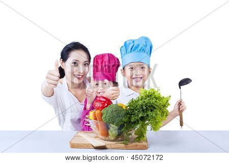 Happy Family Chef Prepare Vegetable Meal On White