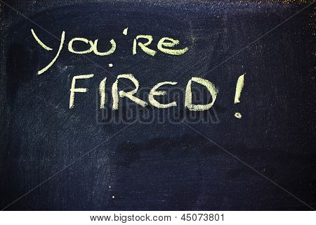You're Fired Message On Chalkboard
