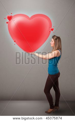 Beautiful young lady holding lovely 3d red heart