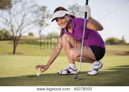 Female golfer caught cheating