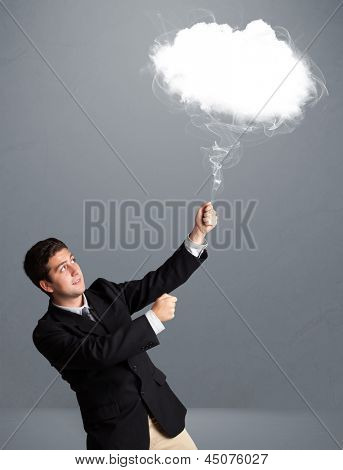 Handsome young man holding cloud