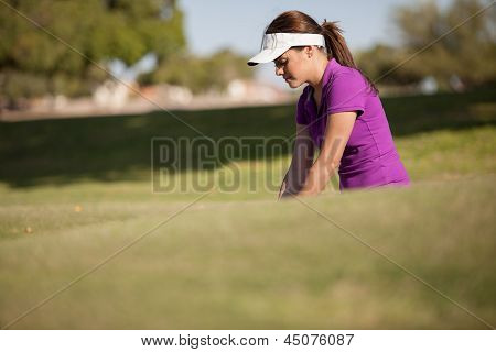 Beautiful woman playing golf