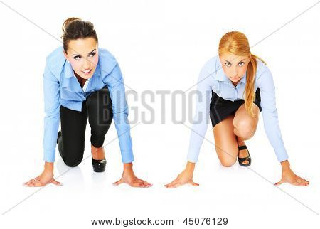 A picture of young businesswomen ready to start a race over white background