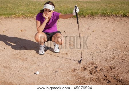 Frustrated golfer in a sand trap