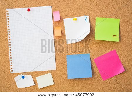 Colour Note Papers On Pin Board. Cork Background