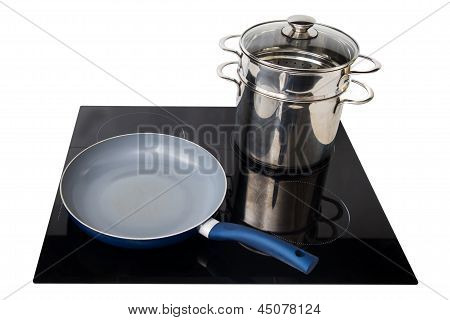 Frying Pan And Pot At The Induction Stove Over The White Background