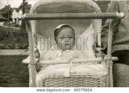 Vintage photo of baby girl in pram (fifties)