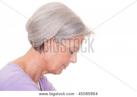 Senior woman in front of white background