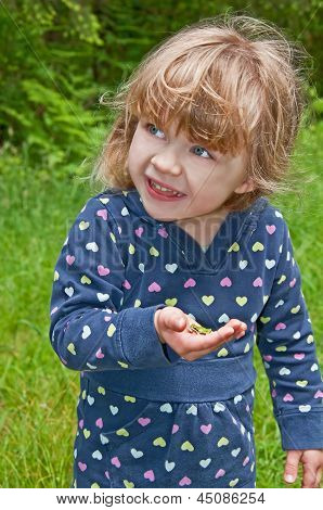 Young Girl Holding Frog