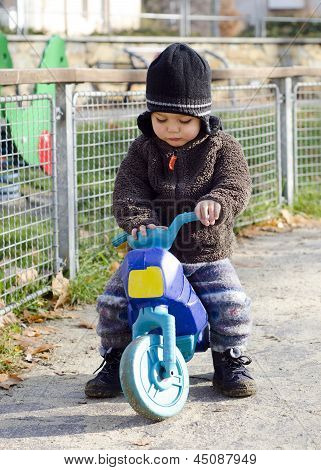 Child on toy bike