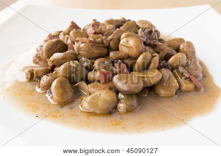 plate of beans with ham