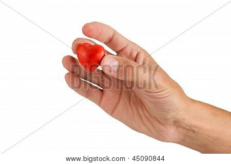 Red Heart Made Of Plasticine In A Hand On A White Backgrou
