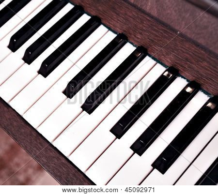 Detail of traditional black and white keys on music keyboard - selective focus