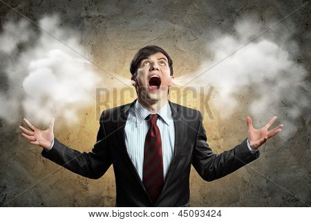 businessman in anger screaming puff going out from ears