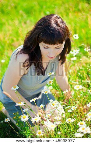 Woman Admiring Camomile