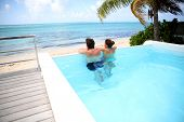 image of infinity pool  - Couple looking at the sea from swimming - JPG