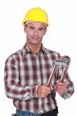 image of bender  - Tradesman using a tube bender - JPG
