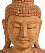 image of siddhartha  - a wooden carving of Buddha on white background - JPG