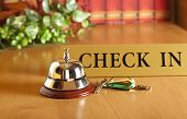 image of motel  - Vintage old hotel bell on the table - JPG
