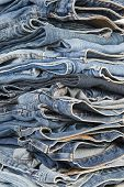Stack Of Different Old Worn Blue Jeans