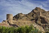 Watchtowers And Defending Walls And Mountains In Old Muscat