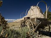 stock photo of trailblazer  - An old abandoned covered wagon on the Oregon Trail - JPG