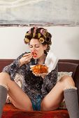 foto of knickers  - sexy girl eating spaghetti on the couch - JPG