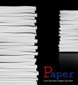 Close up of stack of papers on black background