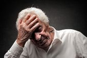 elderly man as a headache