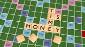 picture of scrabble  - Time is Money Crossword on scrabble board - JPG